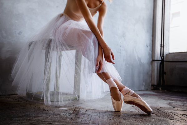 Ballet dancer sitting in a chair