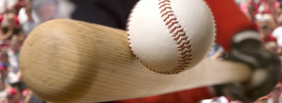 Close up of a baseball bat hitting a ball
