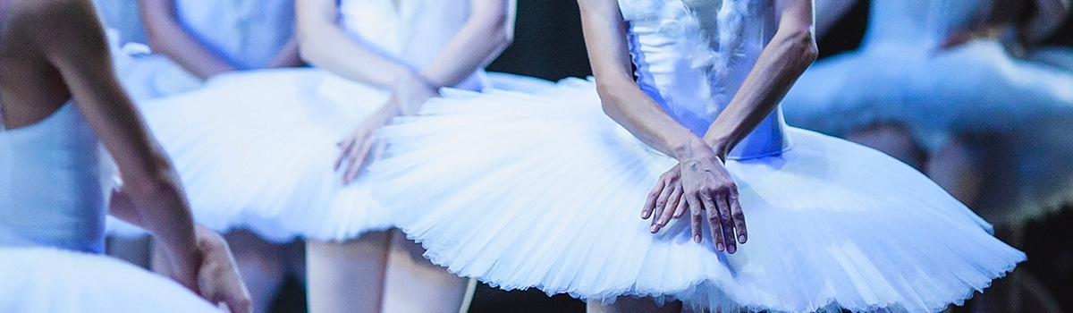 Group of ballet dancers in white tutus