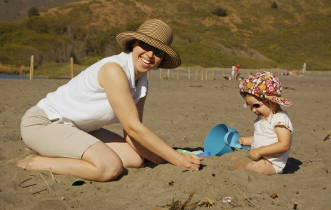 Mother and child playing on a San Francisco beach