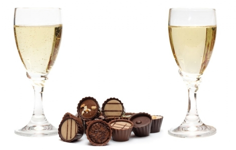 Two glasses of champagne and some chocolates
