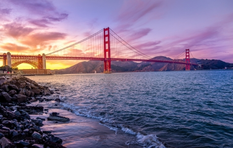 Golden Gate Bridge at Sunrise Beneath a Purple Sky