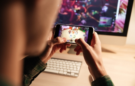 Man playing a mobile video game