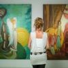 Woman looking at colorful artwork in a gallery